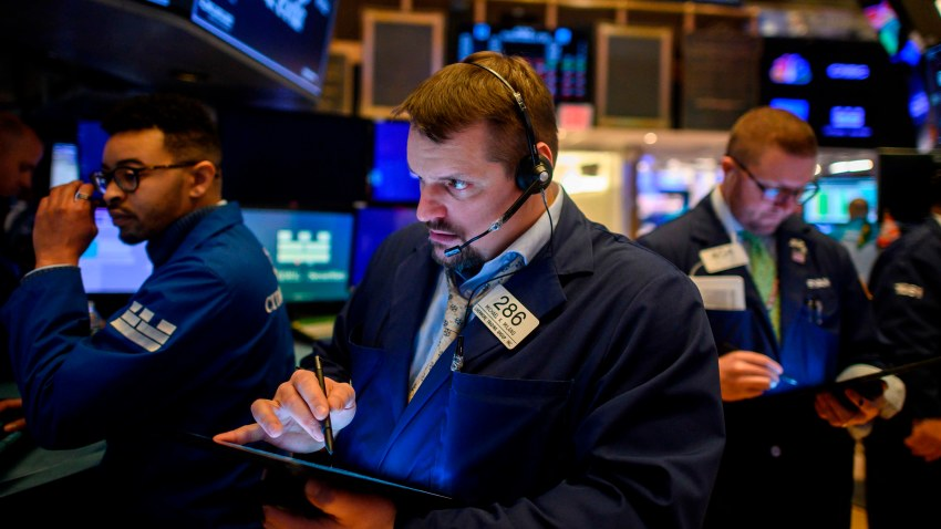 Traders work during the opening bell at the New York Stock Exchange (NYSE) on February 27, 2020 at Wall Street in New York City.