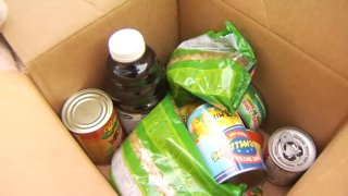 Assorted non-perishable food items in a box