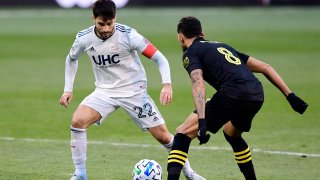 COLUMBUS, OHIO - DECEMBER 06: Carles Gil #22 of New England Revolution controls the ball against Artur #8 of Columbus Crew during the Eastern Conference Final of the MLS Cup Playoffs at MAPFRE Stadium on December 06, 2020 in Columbus, Ohio. Columbus Crew won 1-0.