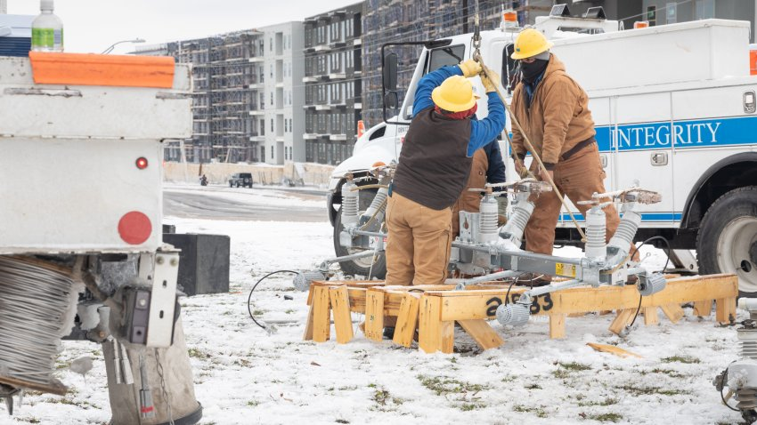 Workers repair a power line in Austin, Texas, U.S., on Wednesday, Feb. 18, 2021. Texas is restricting the flow of natural gas across state lines in an extraordinary move that some are calling a violation of the U.S. Constitutions commerce clause.