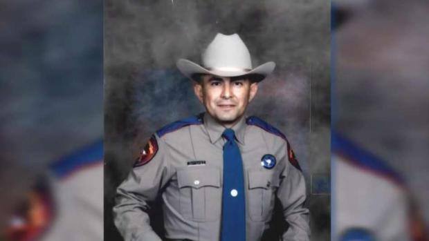 Realizan vigilia en honor a oficial baleado